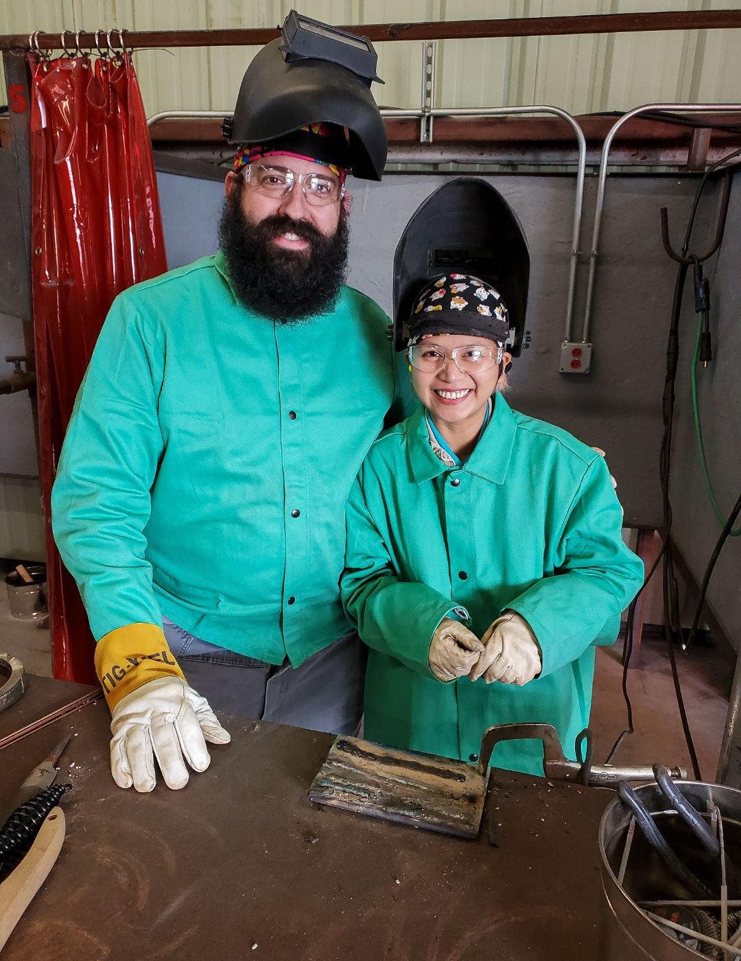 A photo of Chris and Shiela after the welding lesson.